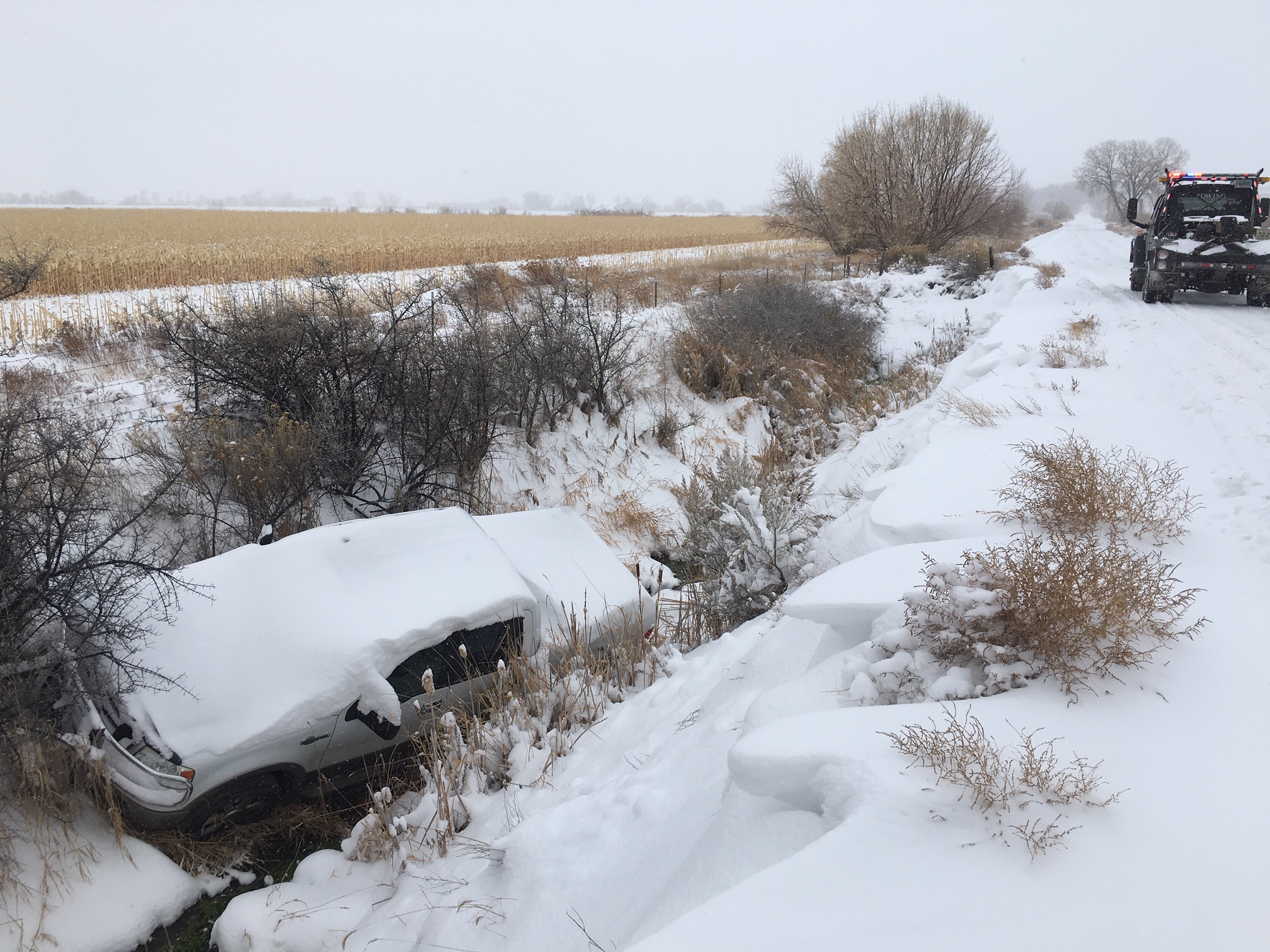 car skid off road towing in snow