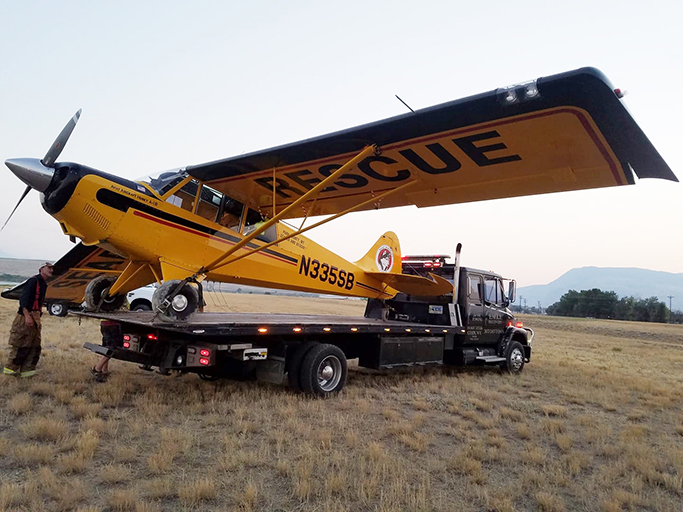airplane on tow truck wyoming
