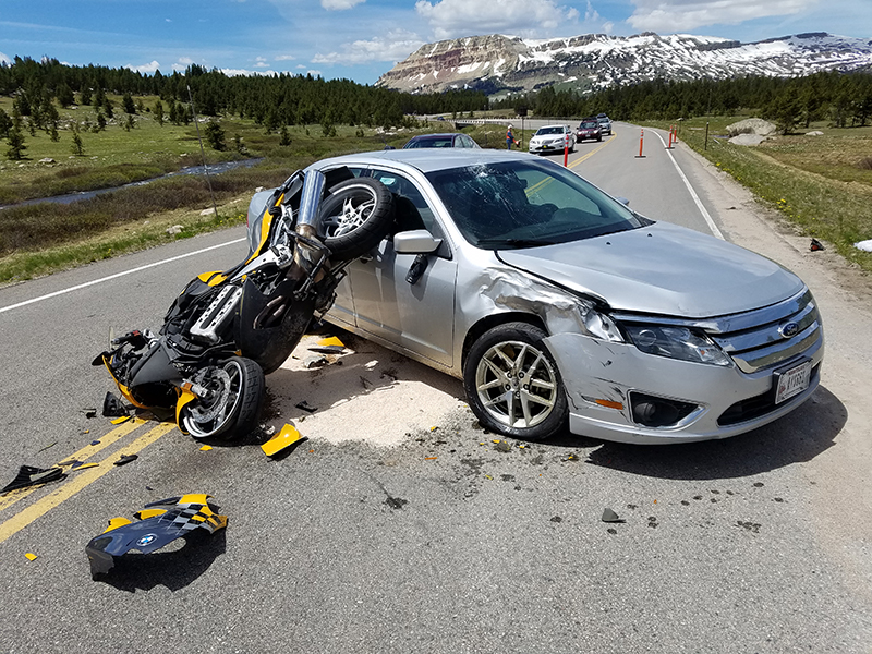 car and motocycle wreck towing